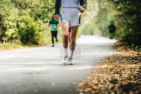 old man running in autumn Park