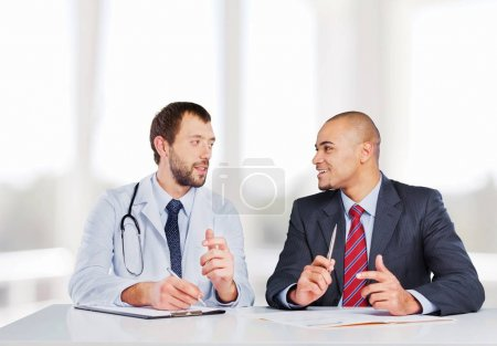 Doctor smiling  with  male  patient