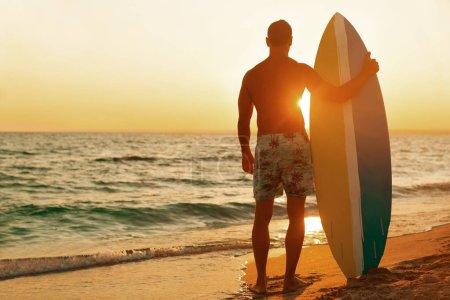 Surfer on the ocean beach