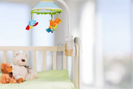 baby cot with toys