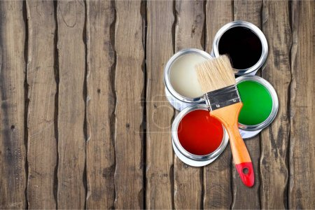Photo for Paint brush and paint cans for  repair on wooden background - Royalty Free Image