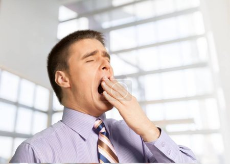 Tired, Yawning young businessman