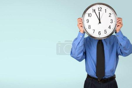 Businessman holding Clock