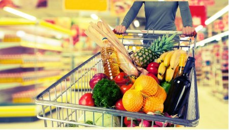Photo for Woman with cart shopping in supermarket - Royalty Free Image