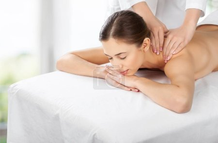 Photo for Beautiful young woman relaxing with massage at beauty spa - Royalty Free Image