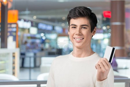 Handsome Teenager with credit card