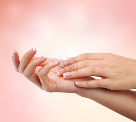 woman's nails with  french manicure