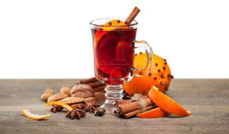 Photo for Mulled wine with cinnamon on background - Royalty Free Image