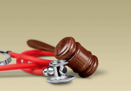 gavel and stethoscope  on background