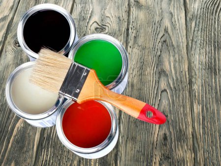 Paint brush and paint cans