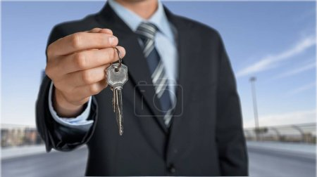 Real estate agent giving Key