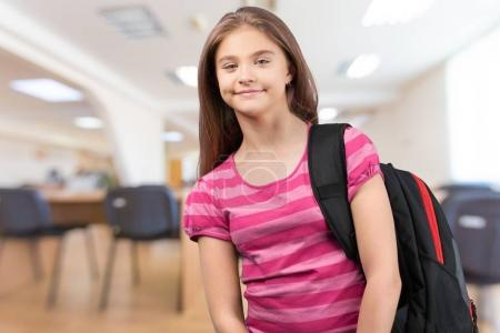 little student girl in class