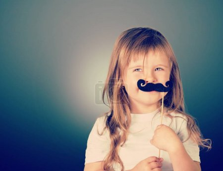 girl with paper black mustache