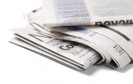 pile of printed newspapers