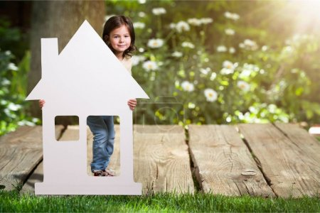 Cute little girl with home