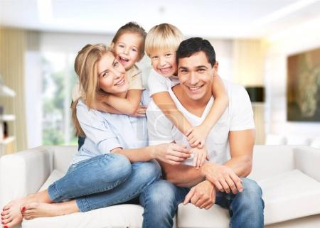 Photo for Young  family at home smiling at camera - Royalty Free Image