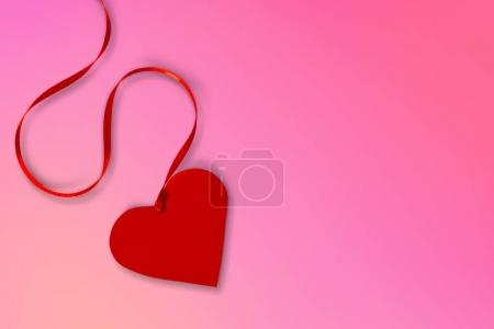 Red bright heart on background