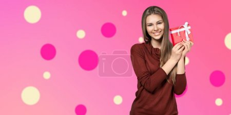 cute young woman holding red gift in hands