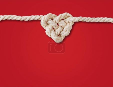 Biały sznur w sercu kształt węzeł na czerwonym tle. Koncepcja miłości.