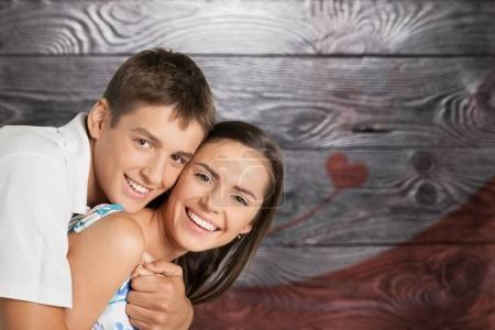 portrait of happy young couple isolated on  background