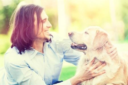 happy guy  and labrador retriever dog
