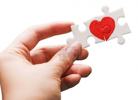 Close-up red Heart in female hand, love concept