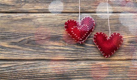 close-up of red hearts on wooden background for Valentines Day