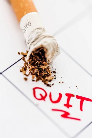 cigarette butt with ash isolated on background