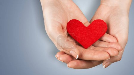 Close-up red Heart in female hands, love concept