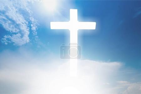 close-up of white cross on blue sky background