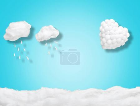 close-up of white heart with white cotton clouds on blue background