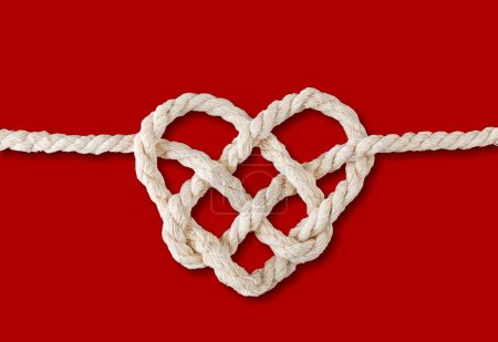 rope with heart isolated on red background