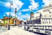Warsaw, Poland  July 14, 2017: Plac Zamkowy - The castle square in Warsaw in Old Town with royal palace. Tourists walk around the castle square. Sunny summer day. Vintage retro style view.