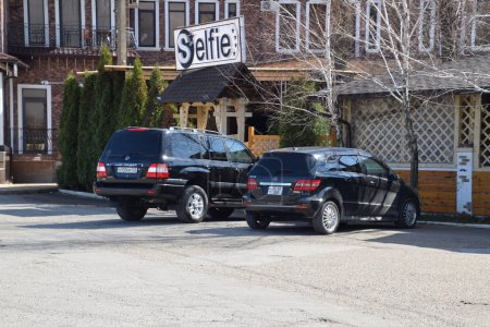 Land Cruiser Prado from Toyota, and Mercedes b200. The car is parked near the cafe.