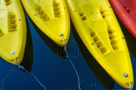 Yellow and red kayaks on blue water