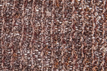 Textural background of melange boucle fabric with lurex thread