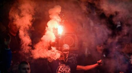 Football supporters with flares