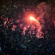 Постер, плакат: Football supporters with flares
