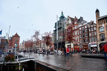 Amsterdam, Netherlands - November 22, 2017: The architecture of the historic center of Amsterdam along the canals.