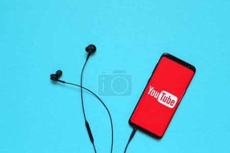 RUSSIA, Tyumen - February 10, 2018: Photo of mobile device with a YouTube search app running