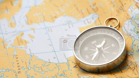 Close up of compass on tourist map background