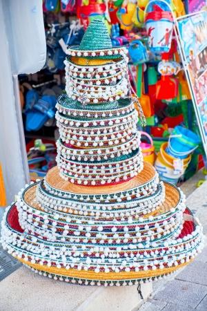 Stacked Mexican sombreros at a street market. Traditional colorful Mexican sombrero hats