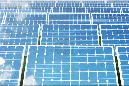 Photo for 3D illustration solar panels on a red roof reflecting the cloudless blue sky. Energy and electricity. Alternative energy, eco or green generators. Power, ecology, technology, electricity. Lighting and - Royalty Free Image