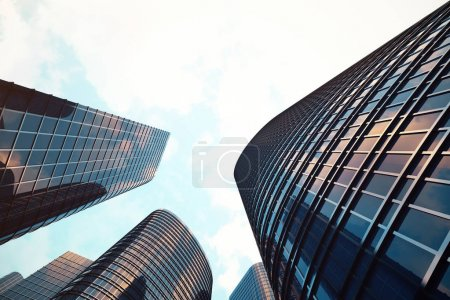 Photo for Low angle view of skyscrapers. Skyscrapers at sunset looking up perspective. Bottom view of modern skyscrapers in business district in evening light at sunset. Business concept of success industry tech architecture. 3D rendering - Royalty Free Image