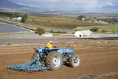 Tractor working a field in Somerset West South Africa