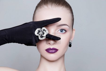 sexy Blond Girl in Gloves and jewelry