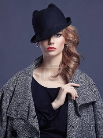 Photo for Fashion portrait of beautiful young woman in hat.blond girl with make-up - Royalty Free Image