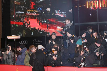 Photographers pose on the red carpet during opening ceremony