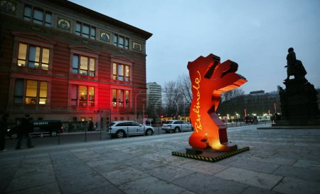 A Berlinale bear figure is seen as people