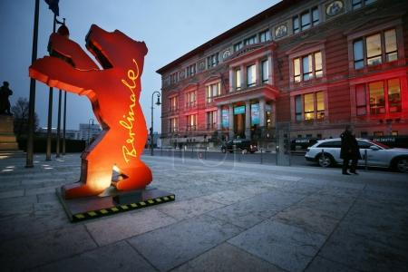 A Berlinale bear figure is seen as people
